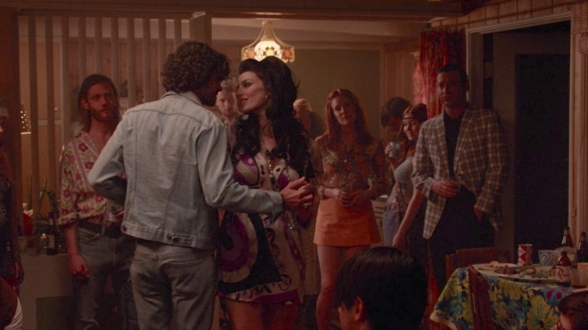 Drink in hand, Don watches as yet another lover shares a demonstrative moment during a drug-fueled Bohemian bacchanal. Familiar territory, but at least he has a co-observer in Amy... and an eventual escape in the unexpected form of a characteristically talkative Harry Crane.