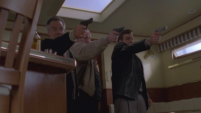 Paulie and Silvio flank Tony as they take his lead in firing into their former friend. They honor his request not to be shot in the face but pop him full of nines before he can fulfill his second request of sitting down for his execution.