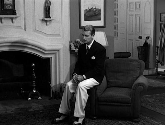 Ladd's Gatsby takes a moment of solitude in his navy blazer and white trousers. His affectations of pocket square and spectator shoes would have been uncharacteristic for DiCaprio's Hughes but fine additions to this particular outfit.