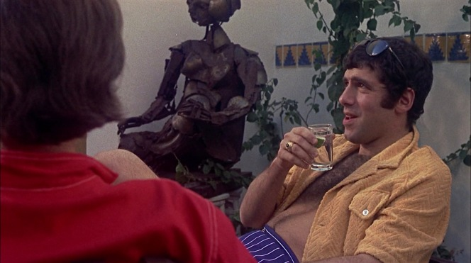 In addition to his comfortable terry shirt, Ted amplifies his relaxation with a libation that appears to be a classic G&T.
