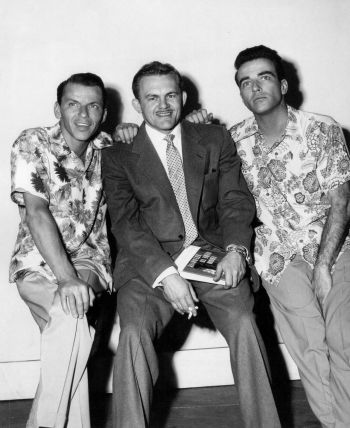 Sinatra and Clift, clad in their Aloha shirts, flanking From Here to Eternity novelist James Jones on set. The three reportedly became fast drinking pals during production.