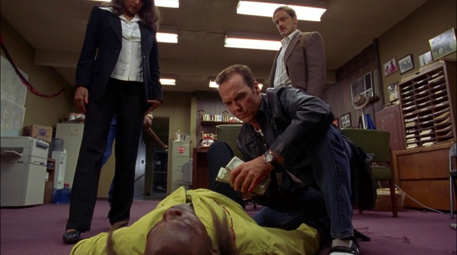 Between Mark Dargus (Michael Bowen) attempting to pull off the Raylan Givens cowboy cop look before it was cool and Ray Nicolette's ill-advised velcro sandals and socks that neutralize an otherwise-cool leather jacket, Jackie Brown is inarguably the best-dressed person in the room.