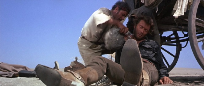 With Bill Carson dead behind him, Tuco makes an effort to hydrate his enemy-turned-friend Blondie.