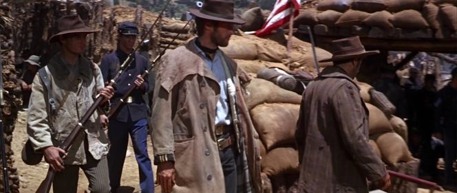 """New """"enlistees"""" Blondie and Tuco are given a grand tour of the Union encampment by the drunken captain (Aldo Giuffrè)."""