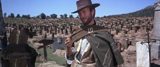 With his hat, poncho, and cigar, the Man with No Name completes his image.