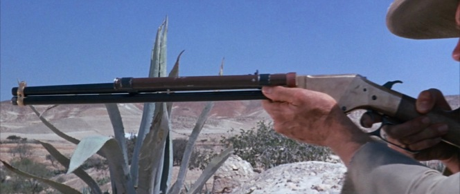 Blondie and his converted Winchester rifle (with the wooden fore-end removed to resemble a Henry) are now in the service of a doomed outlaw named Shorty. This shot of the left side shows more of the scope.