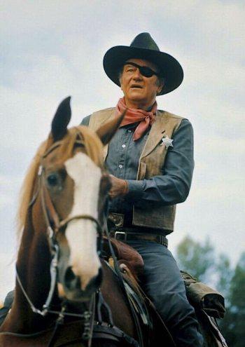 "John Wayne as Reuben ""Rooster"" Cogburn in True Grit (1969)"
