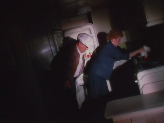 Tacy starts preparing dinner in the darkened, sloping trailer, while Nicky prepares to head outside and straighten it out.