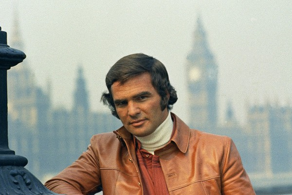 Burt Reynolds, photographed in London in September 1972 wearing a leather jacket and turtleneck that would have had a place in Rick Dalton's closet.