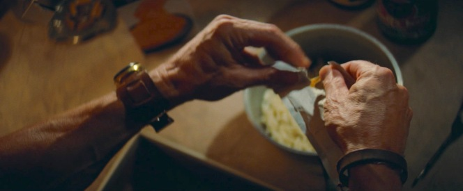 Cliff tears into the packet of processed orange cheese sauce mix that makes Kraft's macaroni and cheese such a delight.