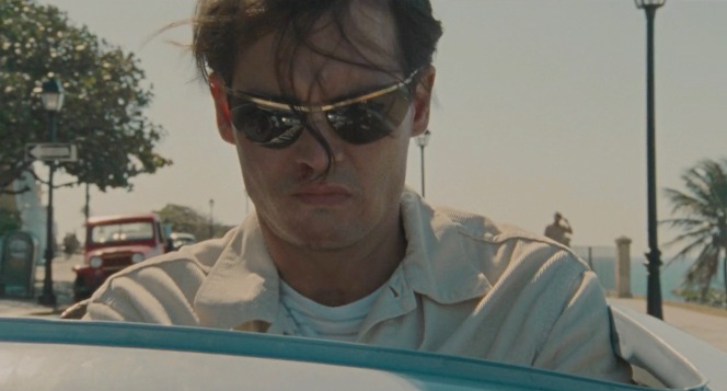 """Kemp's jet age """"Spectacular"""" sunglasses protect his eyes from the bright Caribbean mid-day sun... and nurse his lingering hangover from his chaotic night."""