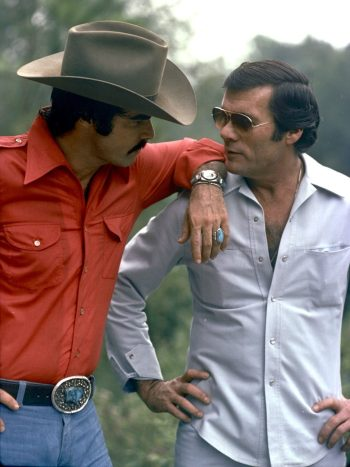 Burt Reynolds and Hal Needham during production of Smokey and the Bandit. The friendship and professional association between the actor and stuntman would inspire the Rick Dalton and Cliff Booth characters and dynamic in Quentin Tarantino's Once Upon a Time in Hollywood (2019).