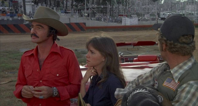 """At the end of their journey, the Bandit, Snowman, and Fred have acquired a new traveling companion in Frog, who enthusiastically agrees to take on the Burdettes' """"double or nothing"""" bet to bring back clam chowder from Boston in Big Enos' Cadillac within the next 18 hours."""