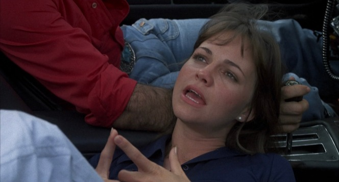 Resting her head on the Bandit's hand (which is gripping the gearshift), Frog recalls her one-time romance with an acid rock singer. In a car with a manual transmission, this would be a very uncomfortable position for both parties, but the gearshift clearly indicates an automatic transmission.