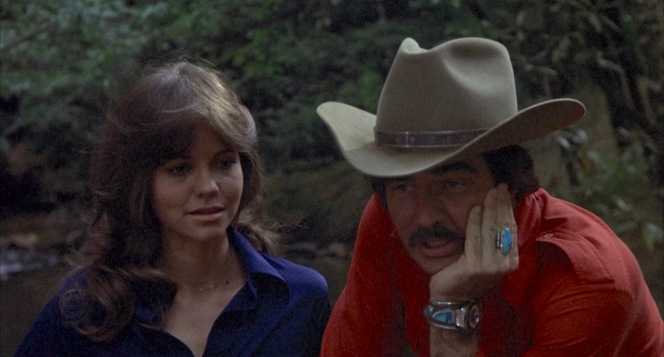 """Frog and the Bandit consider how to spend a few minutes of respite in the woods before she decides: """"Take your hat off."""""""