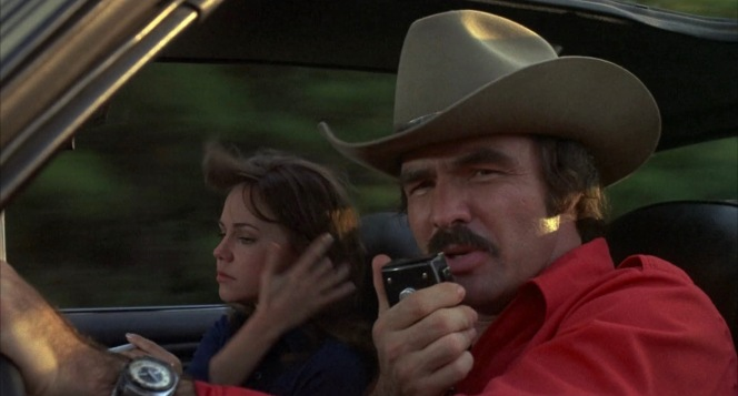 """The Bandit enlists the help of fellow truckers who've """"got them ears on"""", soliciting a smokey report and finding solace in their """"rocking chair"""" to evade the Alabama Highway Patrol."""