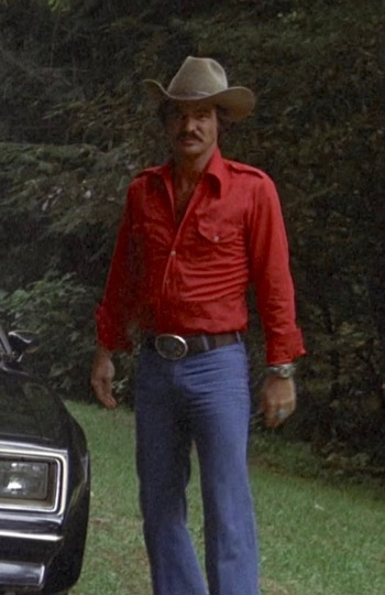 """Burt Reynolds as the Trans Am-driving """"Bandit"""" in Smokey and the Bandit (1977)"""