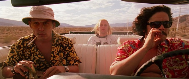 Raoul Duke nervously eyes the hitchhiker in their backseat, making his inaugural convertible ride as Dr. Gonzo steers the trio across the desert. While our two protagonists are clad in their respective Acapulco shirts, the hitchhiker wears a t-shirt with Ralph Steadman's illustration of Mickey Mouse emblazoned on the front.