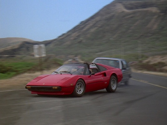 "Speeding ahead in Robin Masters' Ferrari, Magnum cuts off Higgins' Audi in ""No Need to Know"" (Episode 1.05)."