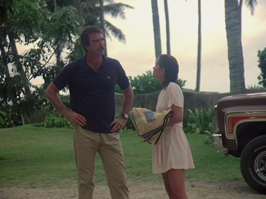Magnum's navy short-sleeved polo shirt and tan trousers proves its timelessness as a comfortable tropical ensemble as James Bond (Daniel Craig) would take the same sartorial approach a quarter century later for a dressed-down day in the Bahamas in <em>Casino Royale</em> (2006).