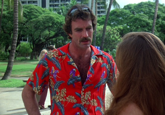 "Thomas Magnum (Tom Selleck) wears his red ""jungle bird"" Paradise Found aloha shirt one of many times on Magnum, P.I., seen here in the episode ""Missing in Action"" (Episode 1.09)."