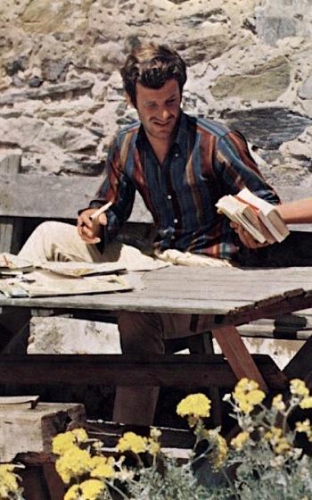 Jean-Paul Belmondo as Ferdinand Griffon in Pierrot le Fou (1965)