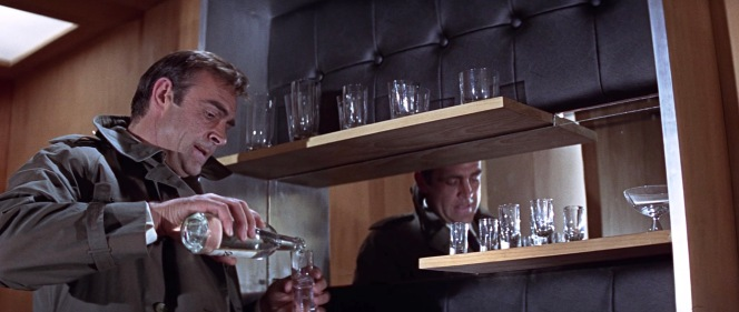 While its contents may be lacking, Osato deserves some credit for having a wickedly interesting office bar complete with leather, assymetrical shelving, and mirror.
