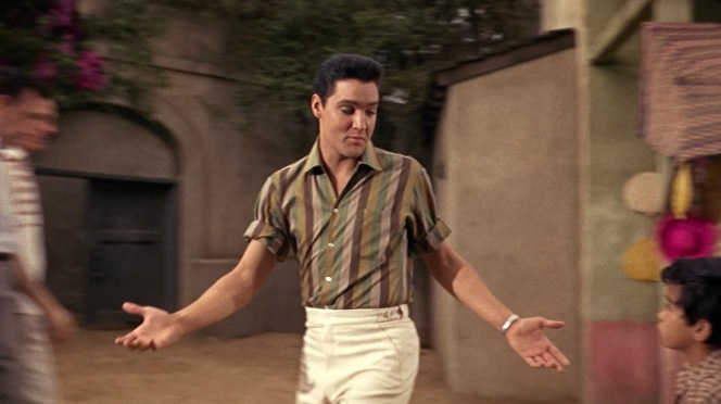 """Elvis wears a different block-striped colorway earlier in Fun in Acapulco. Other than the long sleeves rolled up past the elbow and the slightly thinner striping with green substituting black, there's little difference between this and the """"Marguerita"""" shirt."""