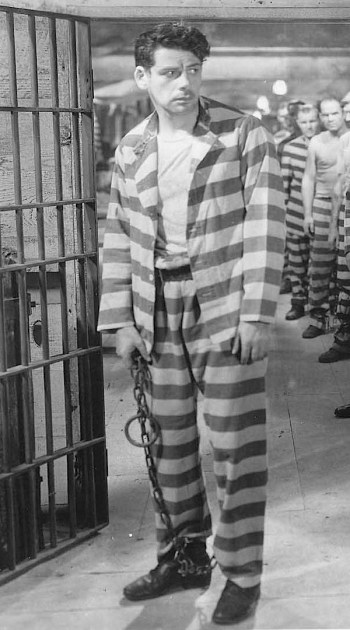Paul Muni in I Am a Fugitive from a Chain Gang (1932), dressed to evoke Harry Madox's potential future as his crimes escalate.