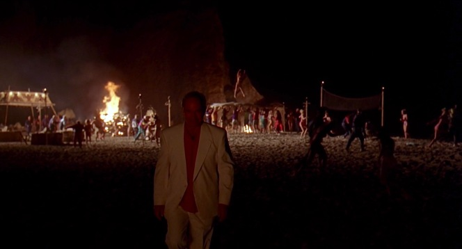 """According to IMDB, the Coen brothers told production designer Rick Heinrichs that they had an Incan-inspired vision for Jackie Treehorn's bacchanal filmed at Point Dume, a """"very Hollywood-looking party in which young, oiled-down, fairly aggressive men walk around with appetizers and drinks. So there's a very sacrificial quality to it."""""""