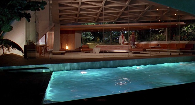 Jackie leads the Dude through his living room, filmed on location at the modish Sheats-Goldstein residence in Beverly Hills.