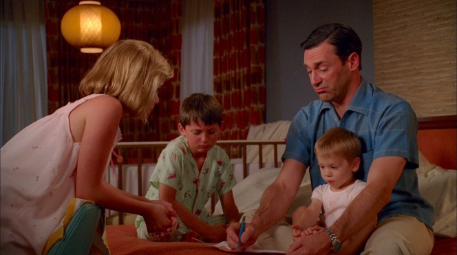 Don plans out a day at Disneyland with his kids Sally (Kiernan Shipka), Bobby (Jared Gilmore), and Gene, though an isolated night in a hotel room may be closer to the reality for many family vacations in 2020.