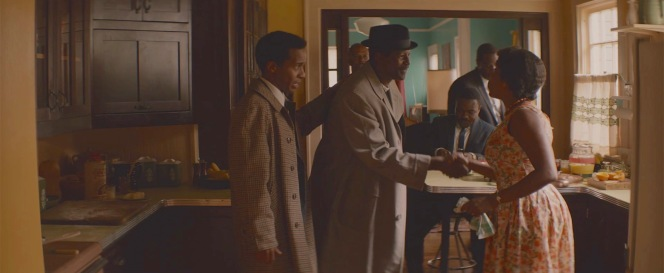 Andrew Young (André Holland) introduces Rev. C.T. Vivian (Corey Reynolds) to Richie Jean Jackson (Niecy Nash).