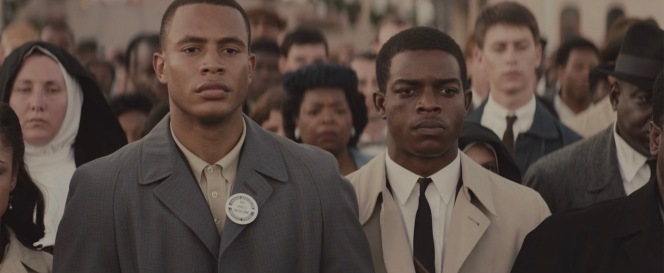SNCC leaders James Foreman (Trai Byers) and John Lewis depicted during the March 9, 1965 march. Note Lewis foregoing his usual tab collar as well as his knapsack.