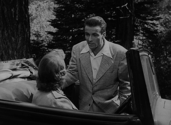 While I would argue that few garments or cuts could look unflattering on an actor like Montgomery Clift, the fashionably full cut of his plaid sport jacket envelops the actor and subliminally suggests that George Eastman may be out of his depth when dressing to impress the upper-class Vickers family and friends.
