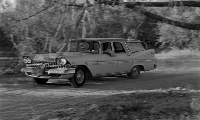 Note the canvas water bag hung from the grille of Homer's Plymouth Sport Suburban, an old trick that relied on evaporation and wind passing the moving vehicle to keep the water cool. Cold water could be an asset for hydrating one's body or radiator when driving through a hot desert, as explained further at Moon-Randolph Homestead.