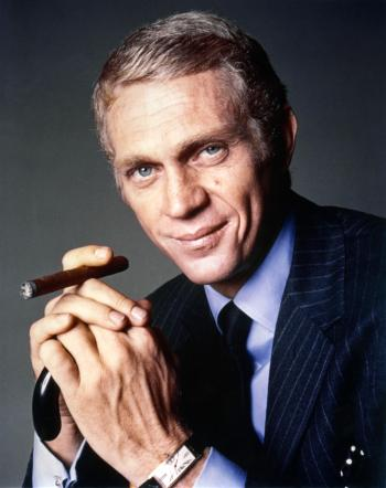 Steve McQueen as Thomas Crown in The Thomas Crown Affair (1968). Note that he dresses his wrist with his Cartier Tank Cintrée rather than the Patek Philippe pocket watch he wears for the actual scene.
