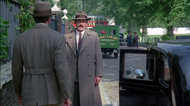 """Lassiter should've known he couldn't go three steps on a London sidewalk wearing a tweed jacket without actually being arrested for it. These guys certainly take their """"no brown in town"""" maxim seriously!"""